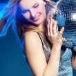 Stock Photo: Womwith disco ball
