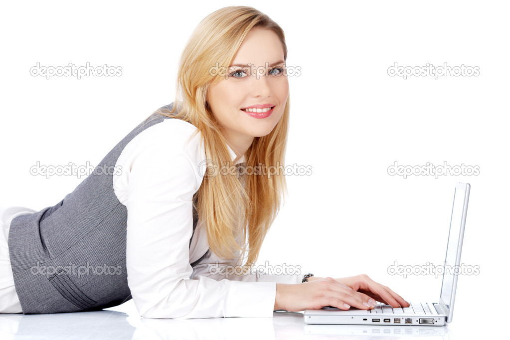 Smiling woman using laptop  Stock Photo #2373581