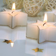 Star shaped candles - Stock Photo