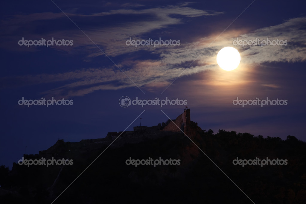A full moon is above a castle  Stock Photo #1831352