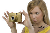 The girl with the gold camera — Стоковое фото