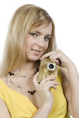 The girl with the gold camera — Stockfoto