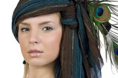 The girl in a scarf with the peacock fea — Stock Photo