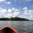 Foto de Stock  : Red kayak and lake
