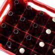 Stock Photo: Red crate of beer bottles