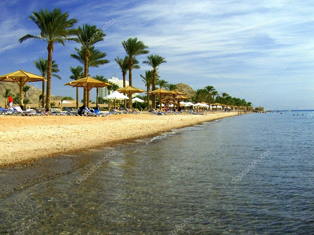 Beach with palms and umbrellas in Egypt, Red Sea — Stock Photo #1740851