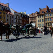 Carriages in Warsaw Old Town, Poland - Stock Photo