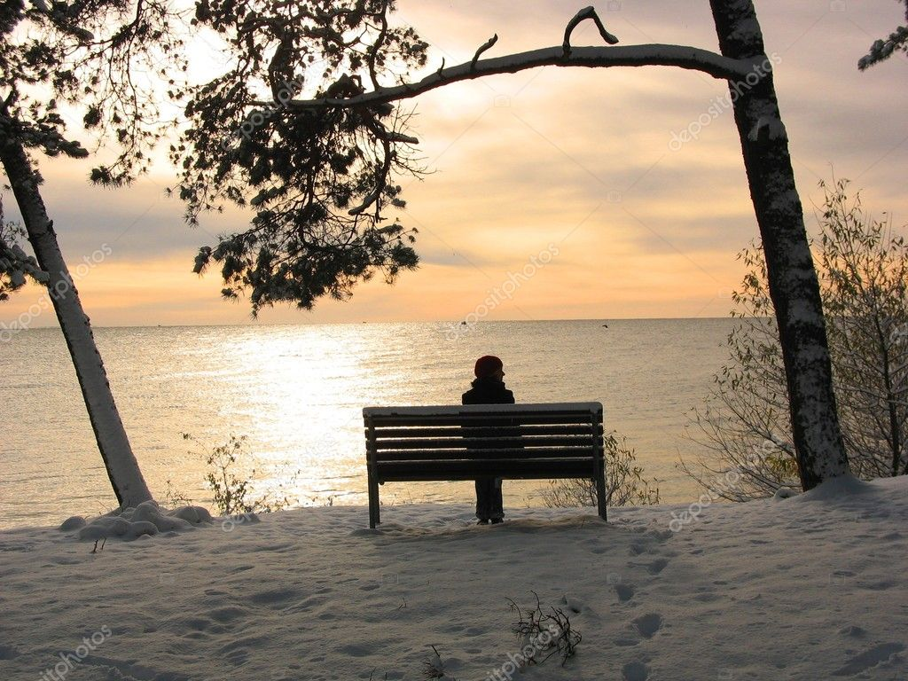 Sunset in Nida, Curonian Spit, girl resting on a bench — Stock Photo #1663421