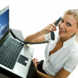 The secretary with the laptop, speaks by phone, — Stock Photo