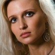 Portrait of beautiful young blonde woman with gr — Stock Photo