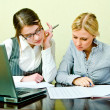 Stock Photo: Two womans work in team