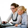 Stock Photo: Two women work in team