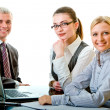 Two women and man work in group — Stock Photo