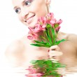 Beautiful nacked girl with flowers — Stock Photo #1662938