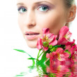 Beautiful nacked girl with flowers — Stock Photo