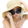 Portrait of the young blonde woman in hat and su — Stock Photo #1664172