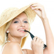 Portrait of the young blonde woman in hat — Stock Photo #1664552