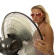 Cute woman holds a fan. — Stock Photo