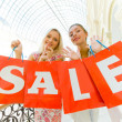 Two women with bags at shopping. Sale. — Stockfoto