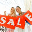 Two women with bags at shopping. Sale. — Stock Photo