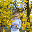 Happy woman in the autumn park — Stock Photo