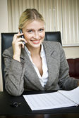 Business woman talks by phone. — Stock Photo