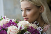Woman's portrait with flowers. — Stock Photo