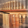 Stock Photo: Old books on shelf