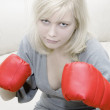 Royalty-Free Stock Photo: The girl in red boxing gloves