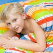 Child on the bed - Stock Photo