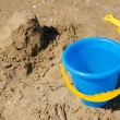 Blue bucket and yellow spade — Stock Photo