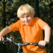 Stock Photo: Young boy on the bike