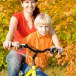 Young happy women and son on bicycle — Foto de Stock