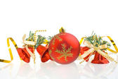 Red Christmas balls and red hand bells — Stock Photo