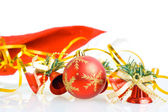 Red Christmas balls and hand bells — Stock Photo
