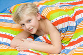 Child on the bed — Stock Photo