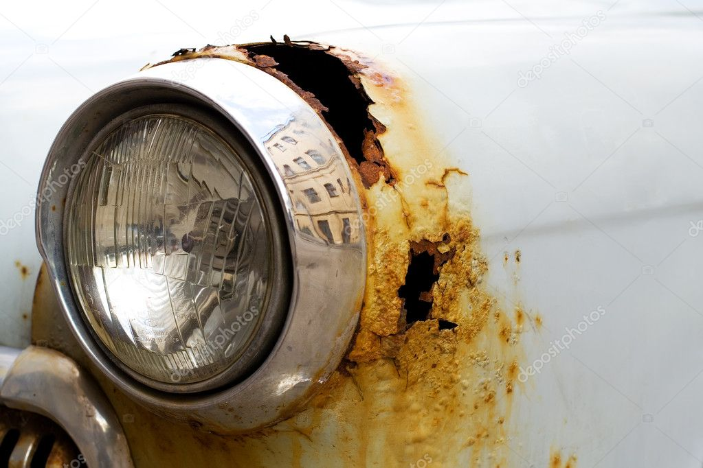 Old car headlight, close-up