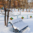 Winter bench covered with snow — Stock Photo