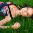 Young nice girl lying on the green grass — Stock Photo #1855318