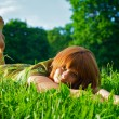 Young girl laying in grass — Stock Photo #1855386