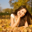 Beautiful woman lying in the park — Stock Photo