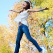 Stock Photo: Happy beautiful girl jumping of joy