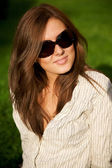 Young pretty smile girl in sunglasses — Stock Photo