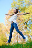 Happy beautiful girl jumping of joy — Stock Photo