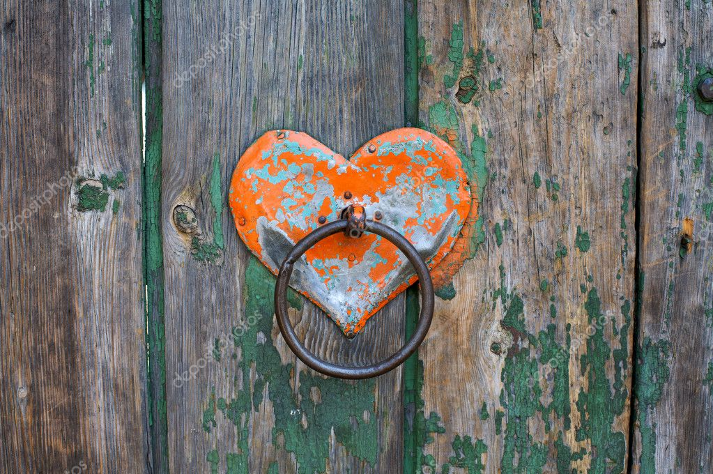 Old rusty gate latch on the wooden door — Stock Photo #1855294