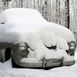 Snow covered old car — Stock Photo