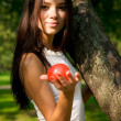 Beautiful girl holding a red apple — Stock Photo