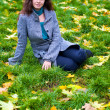 Beautiful young woman in a autumn park — Stock Photo #1913651