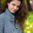 Beautiful young woman in a autumn park — Stock Photo #1913685