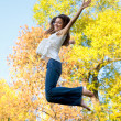 Happy beautiful girl jumping — Stok fotoğraf